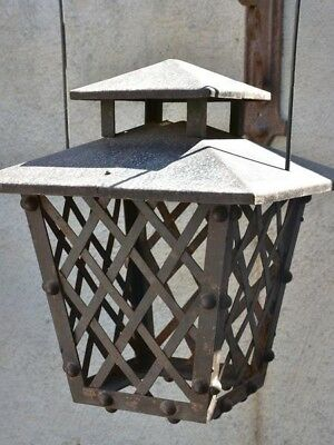 Pair of antique French wrought iron garden lanterns with wall brackets