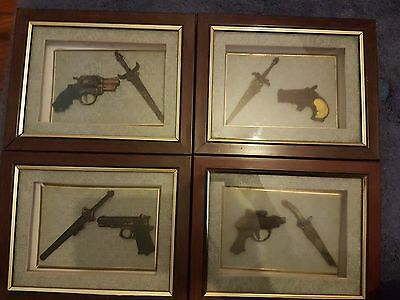 Wall hanging pistols and swords in cases
