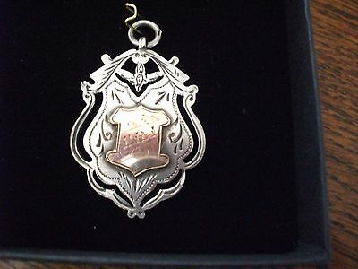 1908 antique solid silver and gold fob medal for a pocket watch chain / pendant.