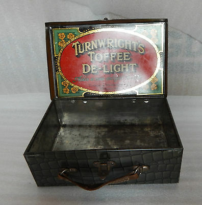 Turner and Wainwrights Deelight Sweet tin in the shape of A suitcase 26x17x9