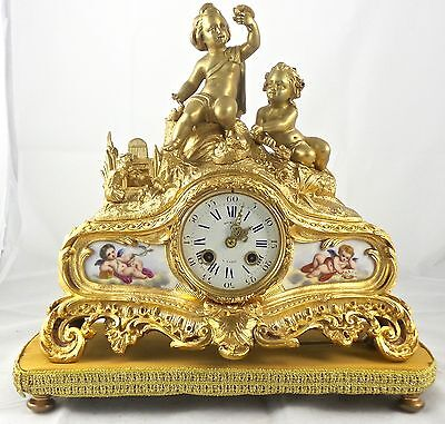 Fine antique French 19thc gilt ormolu bronze & Sevres mantle clock by Henry Marc