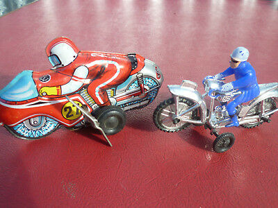 Vintage 1970's motor bikes, one tin (Japan) and one plastic (Hong Kong)