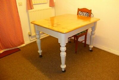 lovely old solid pine fixed top dining table with metal wheels