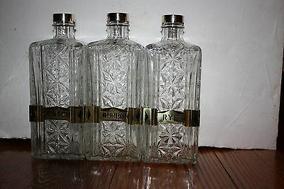 """Set of 3 old gently used cut glass liquor decanters 9 1/2 """" tall & brass labels"""