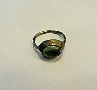 small silver or billon ring with blueish glass stone