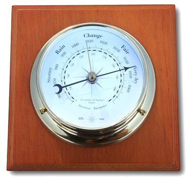 Traditional brass Barometer mounted on varnished wooden plaque
