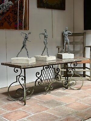 Marble top coffee table with decorative wrought iron base