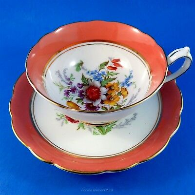 Colorful Floral Bouquet Center with Coral Border Paragon Tea Cup and Saucer Set