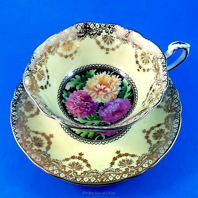 Chrysanthemum Center with a Yellow and Gold Border Paragon Tea Cup and Saucer