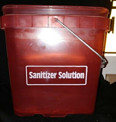 red sanitizer solution bucket