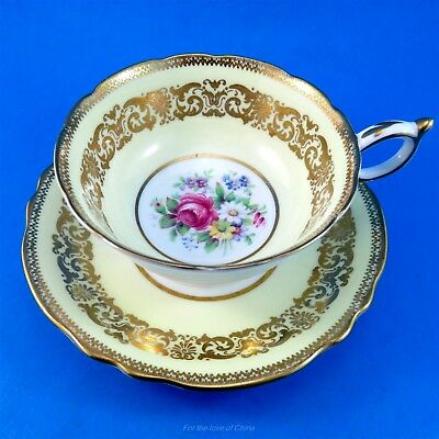 Pretty Yellow & Gold Border with Floral Center Paragon Tea Cup and Saucer Set