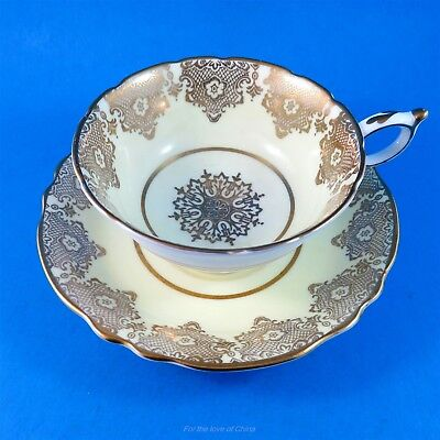 Gold Design with a Star Center on Pale Yellow Paragon Tea Cup and Saucer Set