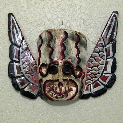 Wooden angel skull mask from Mexico