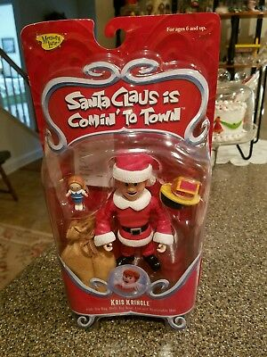 Kris Kringle Figurine-  Santa Claus Is Coming To Town With Box -Playing Mantis