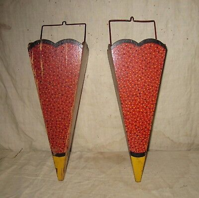 A Pair Of Paint Decorated Flower Cones