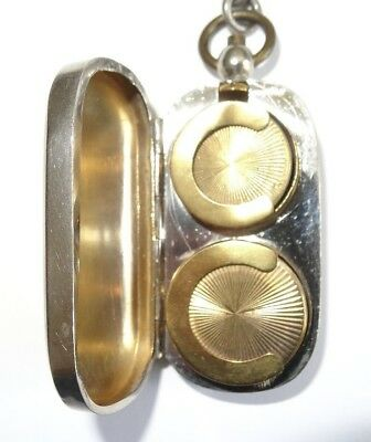 Silver plated, sovereign holder / case/ fob, With silver chain & gilt interior.