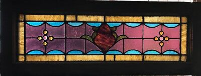 1 of a pair of jeweled stained glass transom windows