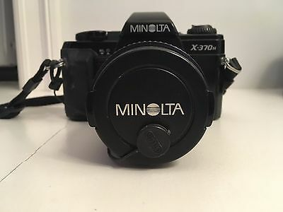 Minolta X370n Camera with 35-70mm Lens, 220x Flash, and Camera Bag