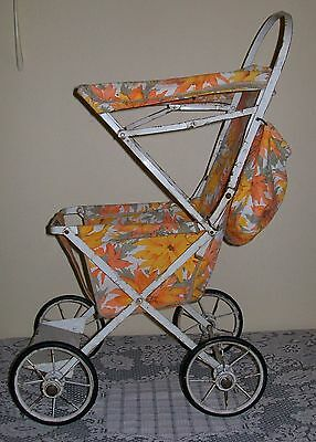VINTAGE RETRO CYCLOPS DOLL PRAM with orange/yellow flower fabric 64cm high