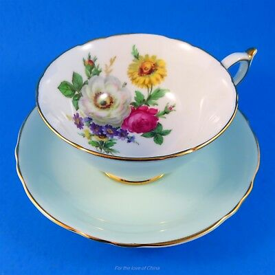 Bright Floral Bouquet with Light Blue Exterior Roslyn Tea Cup and Saucer Set