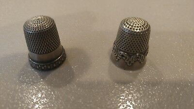 two sterling silver thimbles