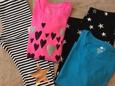 Lot of Girl's Clothing NWT, size 14, leggings and shirts.