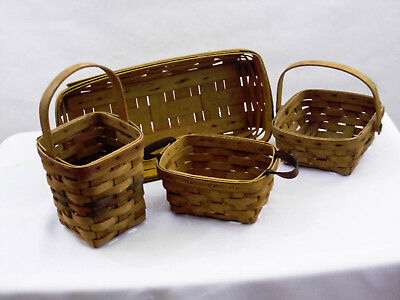 A lot of four Longaberger hand woven baskets All signed years 1992,91,95,99