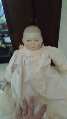 haunted doll. Face changes expressions. Not an evil spirit. Very kind.