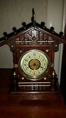 Junghans miniature mantle clock which would grace any collection