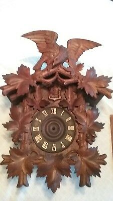 Black Forest cuckoo clock case with Carved Eagle topper and grape/ leaves front