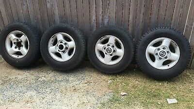 Nissan Navara D22 Genuine alloy wheels with tyres