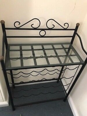 Glass and black iron wine rack
