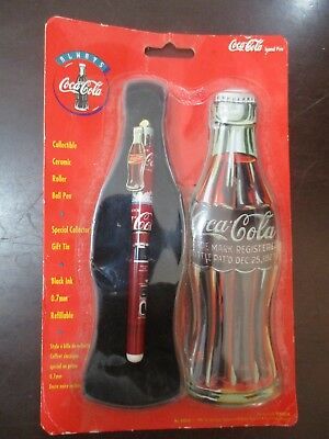 COCA COLA: A  CERAMIC ROLLER BALL PEN IN A SPECIAL GIFT TIN BOX, USA,  90's.
