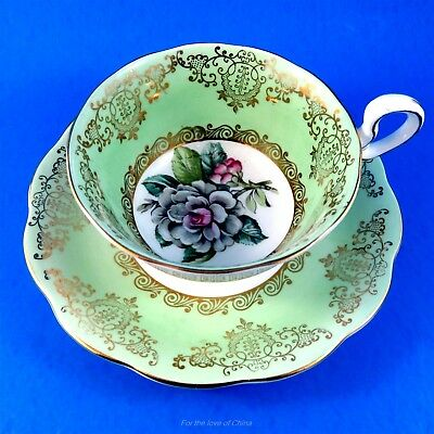 Pretty Green Border with White Magnolia Center Royal Standard Tea Cup and Saucer