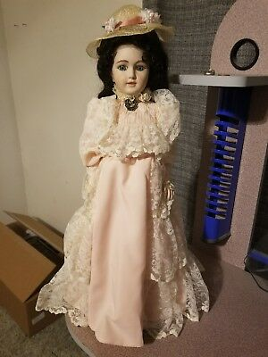 Porcelain shirley temple doll