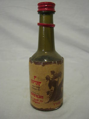 a 95ml  miniature,not sealed  israel wine  bottle from the 60's