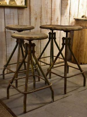 Four vintage industrial French bar stools from a factory