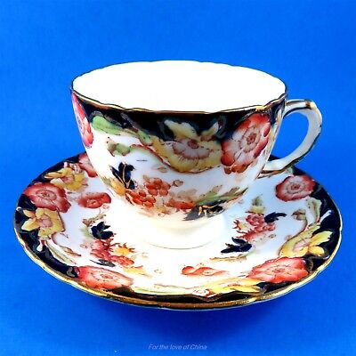 Hand Painted Orange and Cobalt Floral H M Sutherland Tea Cup and Saucer Set