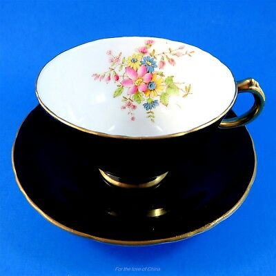 Handpainted Floral with Black Exterior H M Sutherland Tea Cup and Saucer Set