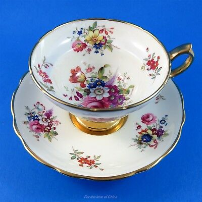 Striking Floral Bouquets on Beige with Pedestal Hammersley Tea Cup and Saucer