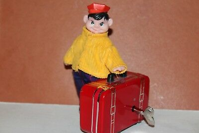Nice Vintage Wind Up  Porter Walking With Suitcase  Works!