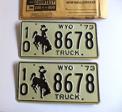"1973 WYOMING TRUCK ""Cowboy"" License Plate vintage pair of tags #10-8678 NOS"