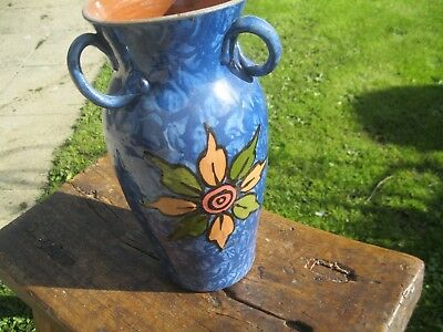 Devon/Torquay large ,30cm, 3 handled vase. .Big bright daisy like flower in fron