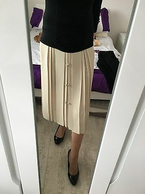 Vintage Womens Quality Bege Pleated  elasticated skirt with decorative buttons.