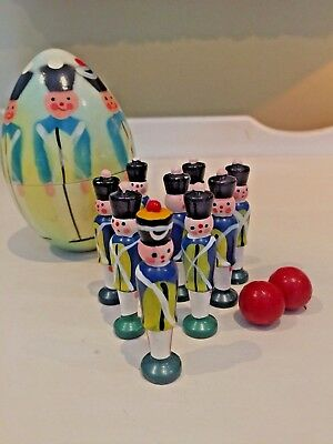 Wooden Nesting Egg Hand painted with 9 Nesting Toy Soldiers and 2 Balls