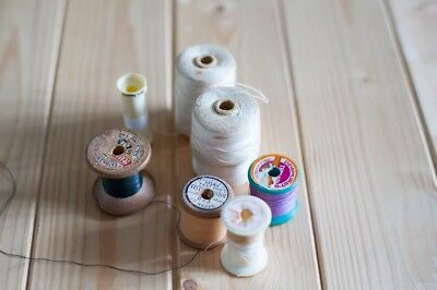 7 vintage wooden reels of sewing thread
