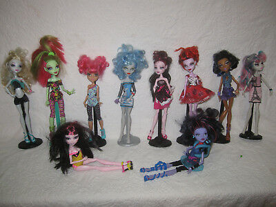 Lot of 10 Monster High Dolls w/clothes and stands