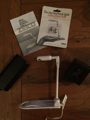 The Itty bitty book light with battery pack, DC charger and  2 new bulbs