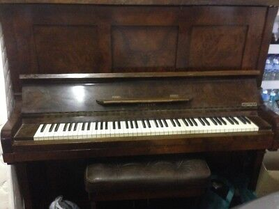 Dresden pianola in good playing condition/bellows need work with piano stool
