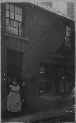 RP PC of Mrs AE Stringer at her shopfront, North Frodingham, Nr Driffield, Hull